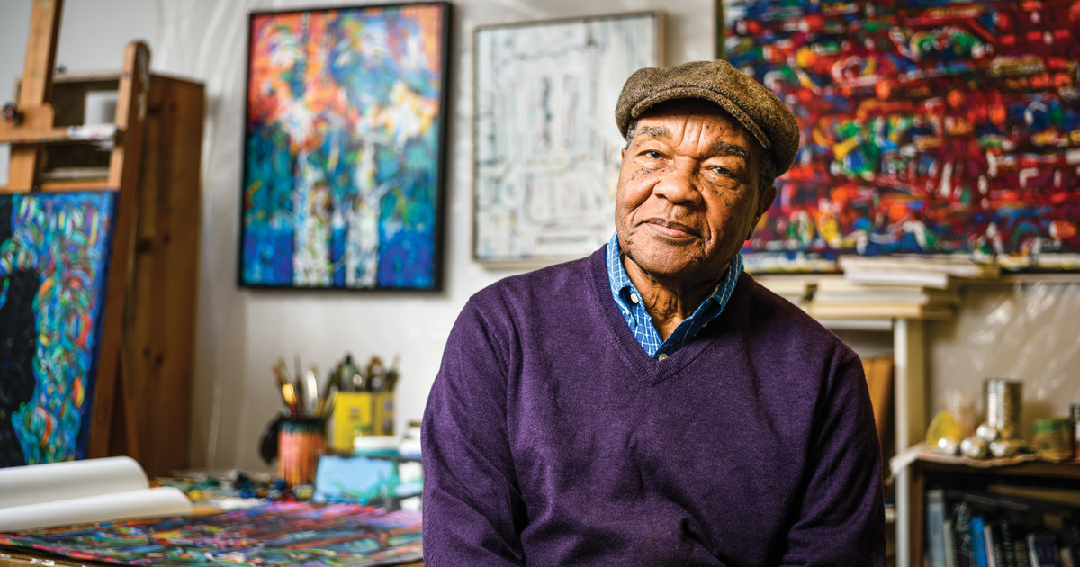 Portrait photograph of David C. Driskell in painting studio